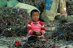 a-chinese-child-sits-amongst-a